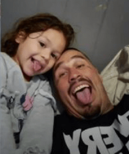 photo of 3-year old with her father