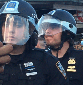 photo of cops hiding their badge numbers