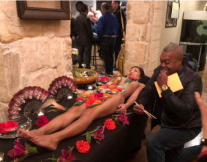 San Antonio Fired Department Chief Charles Hood eats sushi off of naked woman