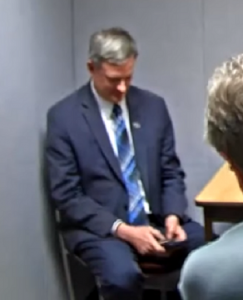 A.G. Ravnsborg on his cell phone during interview for accidentally killing a man with his vehicle