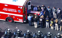 FBI officer's flag-draped body being placed in ambulance